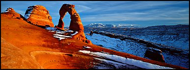 Delicate Arch and snowy mountain. Arches National Park (Panoramic color)