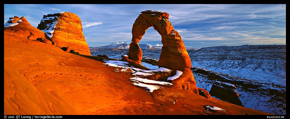 Red sandstone of Delicate Arch and blue shades of snow. Arches National Park (color)
