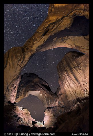 Visitor lighting up Double Arch at night. Arches National Park (color)