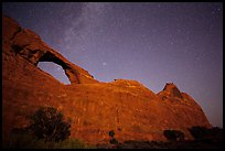 Skyline Arch at night with starry sky. Arches National Park, Utah, USA. (color)