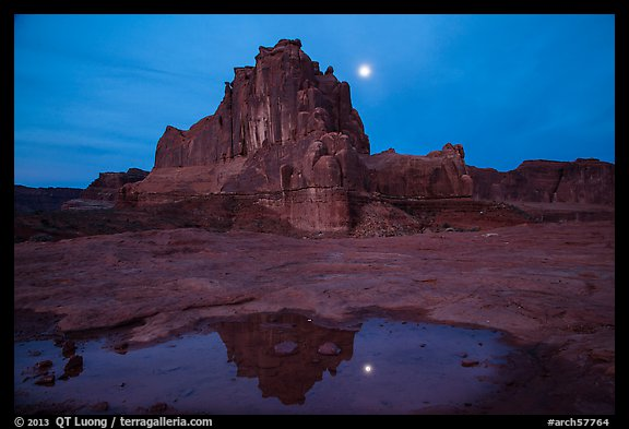 Courthouse tower and moon reflected in pothole. Arches National Park (color)