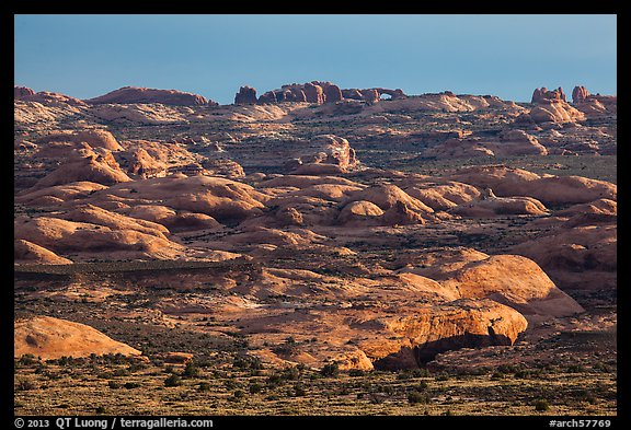 Sandstone domes with arch in background. Arches National Park, Utah, USA.