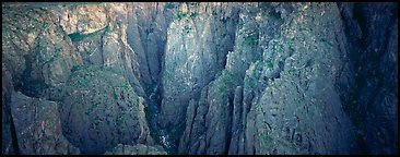 Startling depths and narrow opening of Black Canyon. Black Canyon of the Gunnison National Park (Panoramic color)
