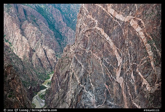 Sheer cliff with flourishes of crystalline pegmatite. Black Canyon of the Gunnison National Park (color)
