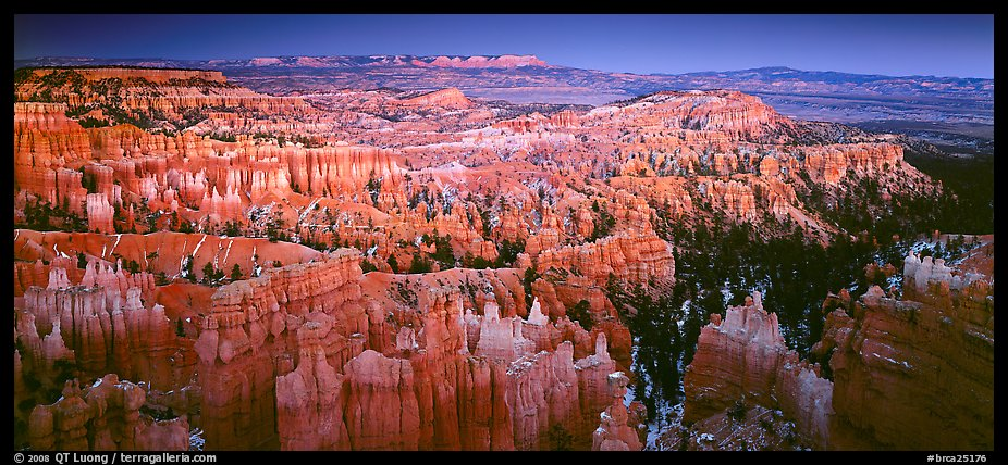 Innumerable brighly colored free-standing hoodoos aligned in amphiteater. Bryce Canyon National Park (color)
