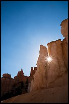 Sun star between hoodoos. Bryce Canyon National Park ( color)