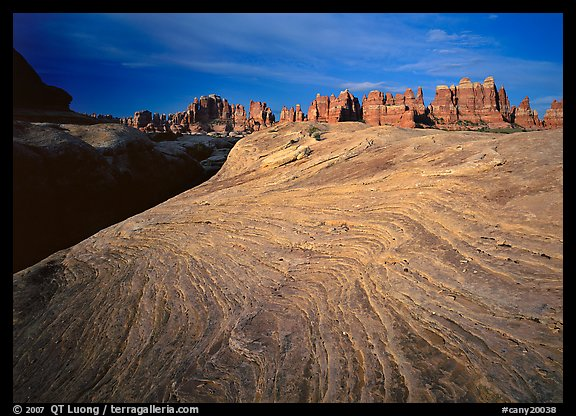 Sandstone swirls and Needles near Elephant Hill at sunrise, the Needles. Canyonlands National Park (color)