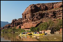 Rafts motoring upstream Colorado River. Canyonlands National Park, Utah, USA. (color)