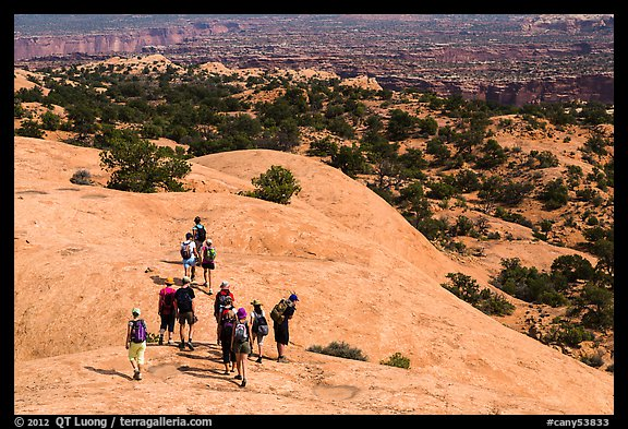 Hikers on Whale Rock. Canyonlands National Park (color)