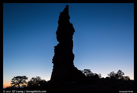 Standing Rock silhouette at sunrise. Canyonlands National Park (color)