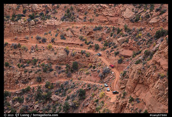 Jeep caravan negotiates hairpin turn on the Flint Trail,  Orange Cliffs Unit, Glen Canyon National Recreation Area, Utah. USA (color)