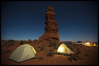 Camp at the base of Standing Rock at night. Canyonlands National Park, Utah, USA.