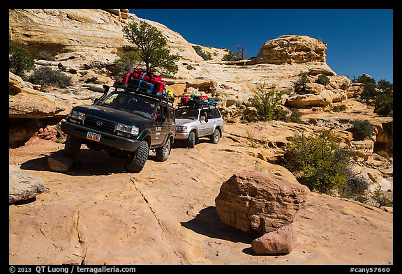 Vehicles on ledge in Teapot Canyon. Canyonlands National Park (color)
