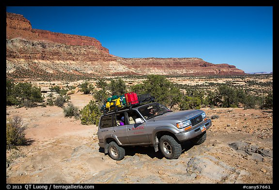 4WD vehicle driving over rocks in Teapot Canyon. Canyonlands National Park (color)