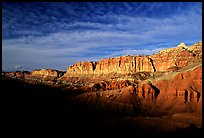 Layers of rock on  West face of Waterpocket Fold at sunset. Capitol Reef National Park, Utah, USA.