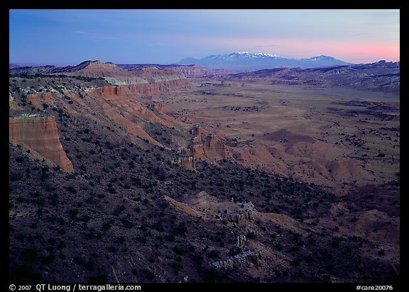 Cliffs, basin, and snowy mountains at dusk, Upper Desert, dusk. Capitol Reef National Park (color)