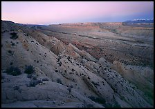 Strike Valley and Waterpocket Fold at dusk. Capitol Reef National Park, Utah, USA. (color)