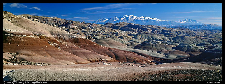 Mudstone landscape and snowy mountains, Cathedral Valley. Capitol Reef National Park (color)