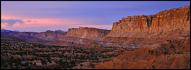 Sandstone cliffs at sunset. Capitol Reef National Park (Panoramic color)