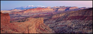 Panorama of multi-hued cliffs and Henry Mountains at dusk. Capitol Reef National Park (Panoramic color)
