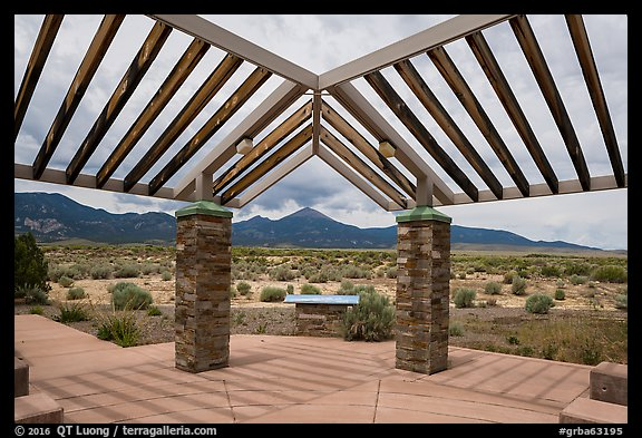 Courtyard, sign and mountains, Great Basin Visitor Center. Great Basin National Park (color)