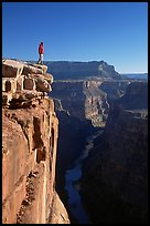 Man standing at  edge of  Grand Canyon at Toroweap, early morning. Grand Canyon National Park, Arizona, USA. (color)
