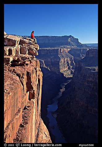 Visitor sitting on  edge of  Grand Canyon, Toroweap. Grand Canyon National Park (color)