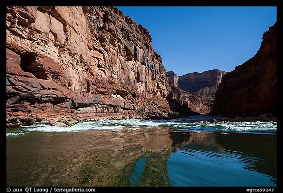 River-level view of glassy waters before rapids, Marble Canyon. Grand Canyon National Park (color)