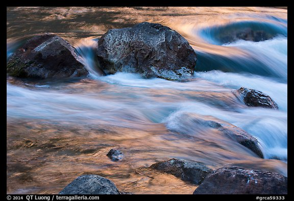 Boulders and rapids with glow from canyon walls reflected. Grand Canyon National Park (color)