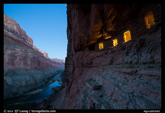 Ancient Nankoweap granaries with windows lit and Colorado River at dusk. Grand Canyon National Park (color)