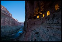 Ancient Nankoweap granaries with windows lit and Colorado River at dusk. Grand Canyon National Park, Arizona, USA.