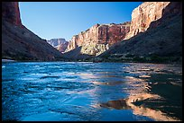 Cliffs reflected in Colorado River rapids, morning. Grand Canyon National Park ( color)