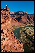 Photographer on sheer cliff above Unkar rapids. Grand Canyon National Park ( color)