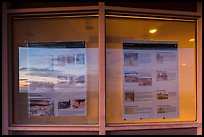 Sunset and attractions listings, Far View visitor center window reflexion. Mesa Verde National Park, Colorado, USA. (color)