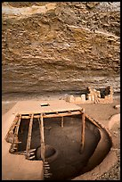 Reconstructed pithouse and original walls below rock roof, Step House. Mesa Verde National Park ( color)
