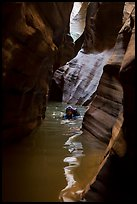Canyoneer in dark flooded Pine Creek Canyon. Zion National Park ( color)