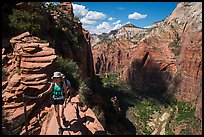 Hiker holds onto chain, Angels Landing. Zion National Park ( color)