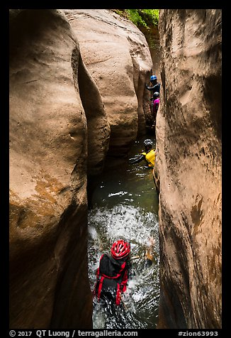 Canyoneers swim through narrows, Upper Left Fork. Zion National Park, Utah (color)
