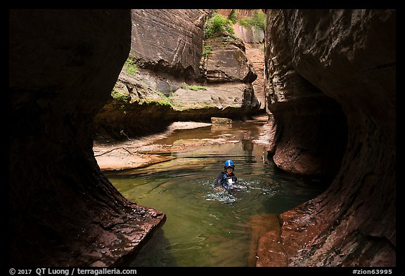 Canyonneer swims in pool, Upper Subway. Zion National Park, Utah (color)