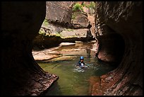 Canyonneer swims in pool, Upper Subway. Zion National Park, Utah ( color)