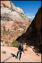 Canyonneer rappels on slab, Behunin Canyon. Zion National Park, Utah ( color)