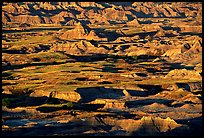 Badland ridges and prairie from above, sunrise. Badlands National Park, South Dakota, USA. (color)