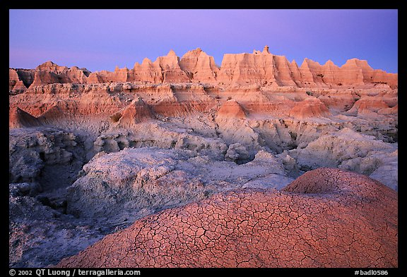 Cracked mud and erosion formations, Cedar Pass, dawn. Badlands National Park (color)