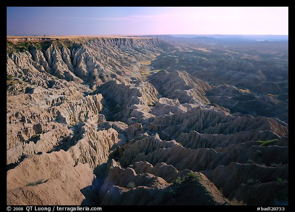 Basin of spires, pinacles, and deeply fluted gorges,  southern unit, early morning. Badlands National Park (color)