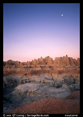 Mud cracks, badlands, and moon at dawn. Badlands National Park (color)