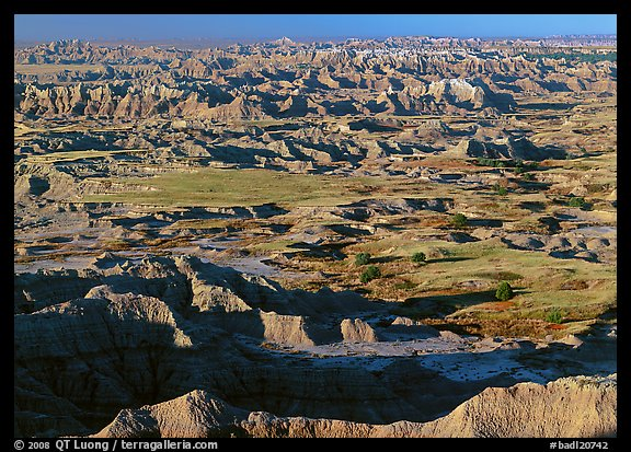 Prairie and eroded ridges stretching to horizon, early morning. Badlands National Park (color)