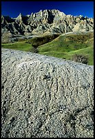 Mudstone badlands and grass prairie. Badlands National Park, South Dakota, USA.