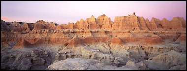 Badlands formations with pastel hues at dawn. Badlands National Park (Panoramic color)