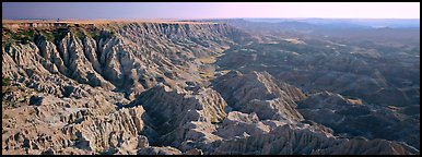 Badlands carved into prairie by erosion, Stronghold Unit. Badlands National Park (Panoramic color)