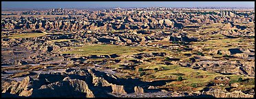 Scenic view of prairie and badlands extending to horizon, Pinnacle Overlook. Badlands National Park (Panoramic color)